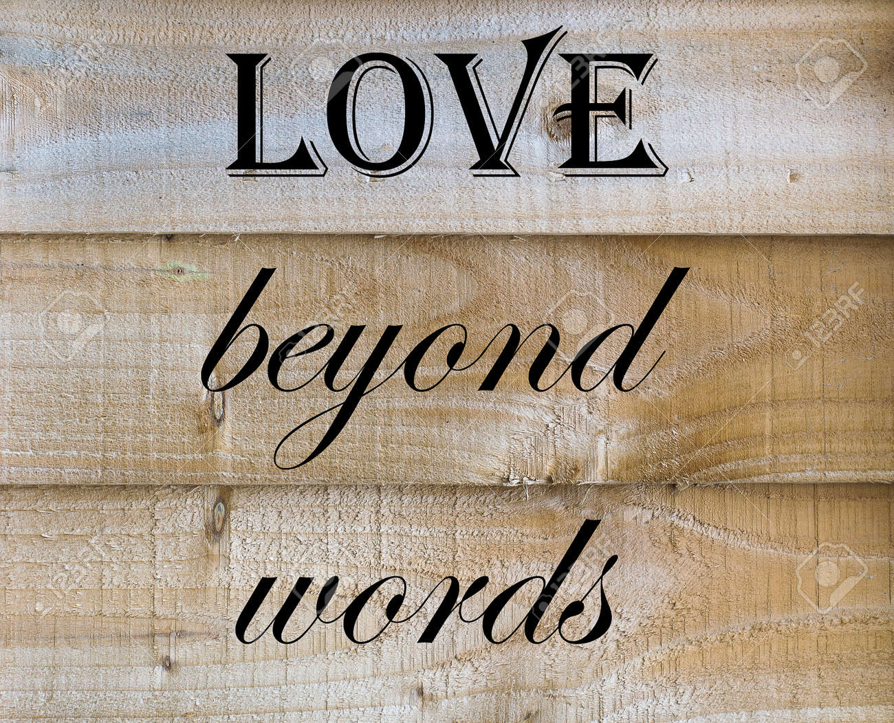 Love Beyond Words Quote On Wooden Background Stock Photo Picture