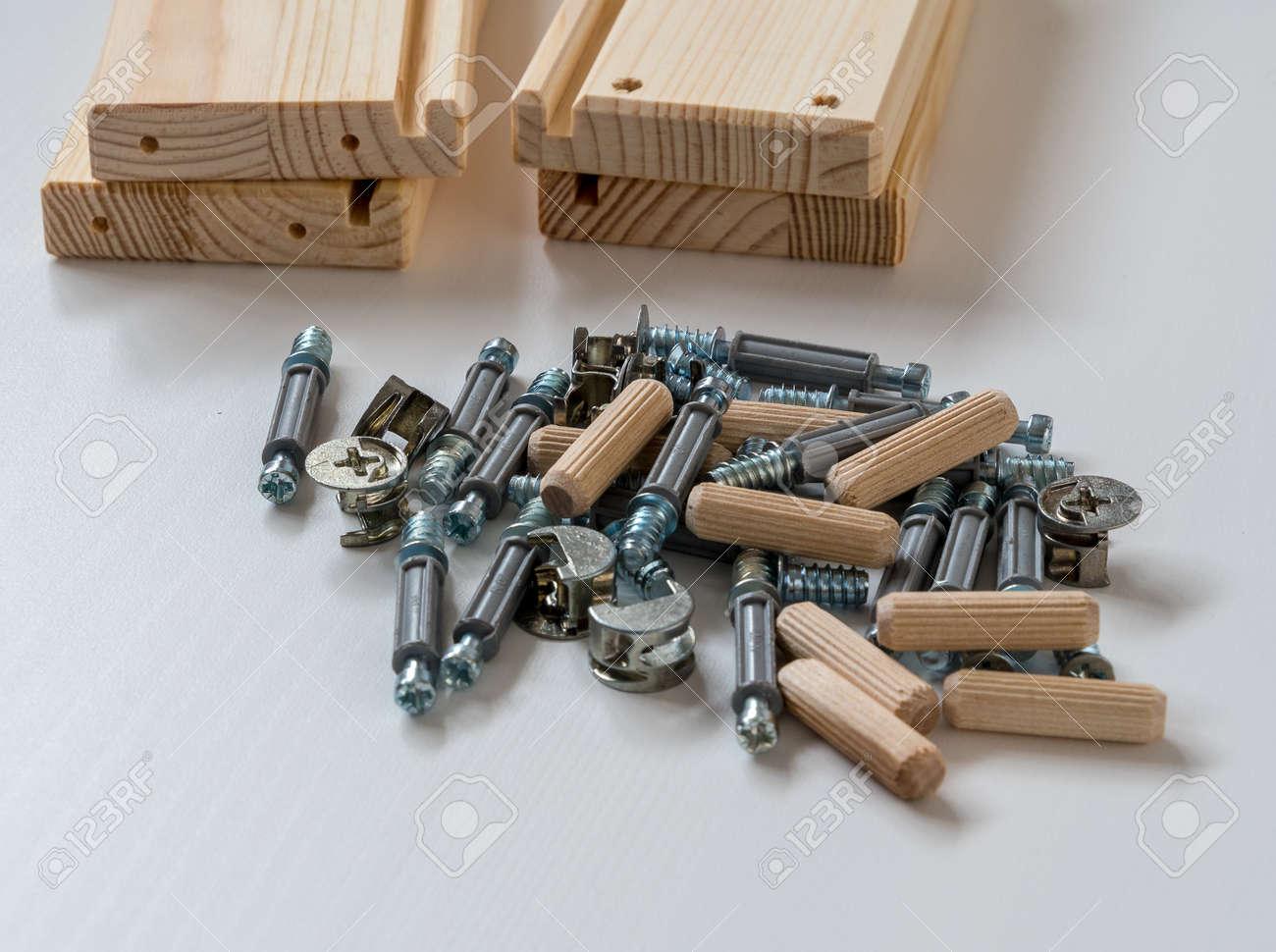 flat pack furniture. An Assortment Of Flat Pack Furniture Fixings Stock Photo - 98828080
