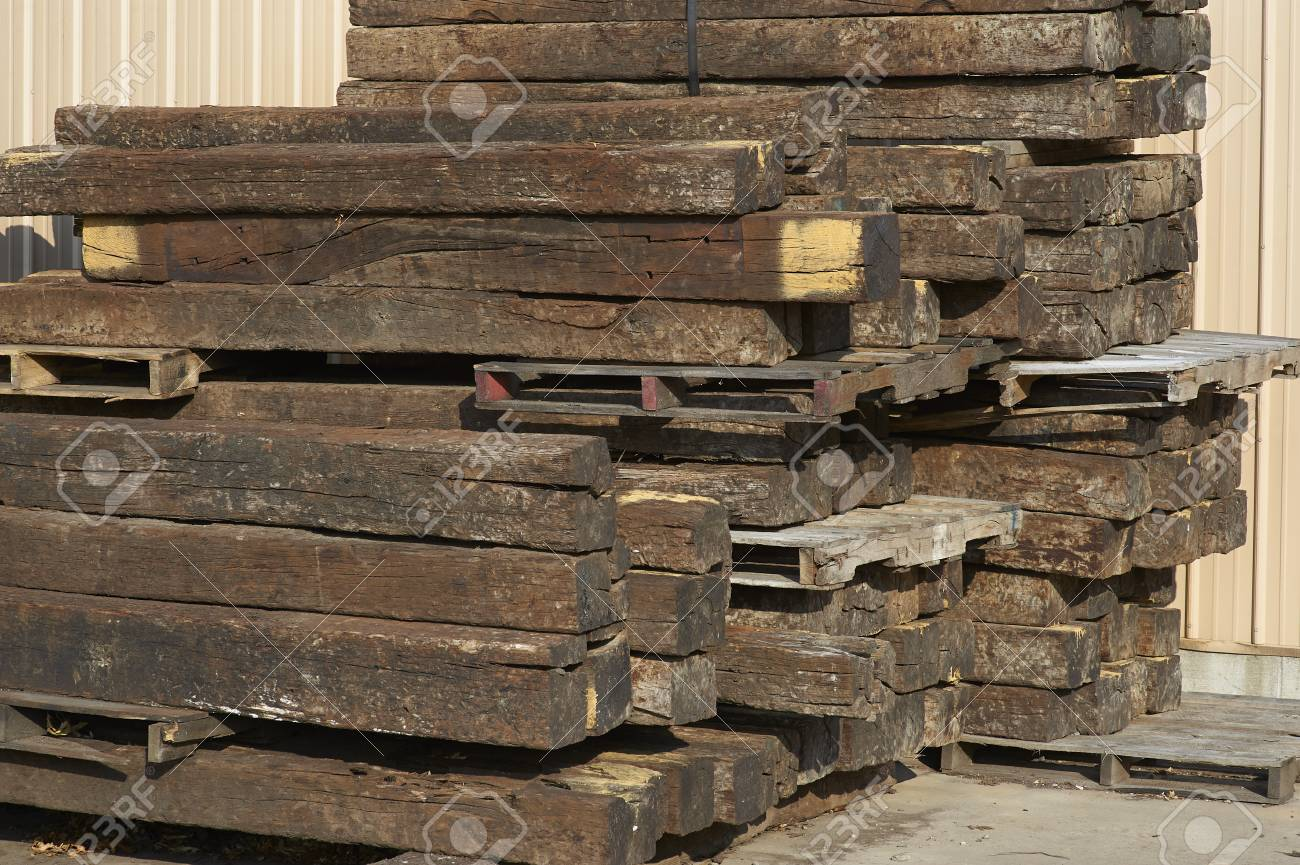 railroad ties stacked against warehouse wall