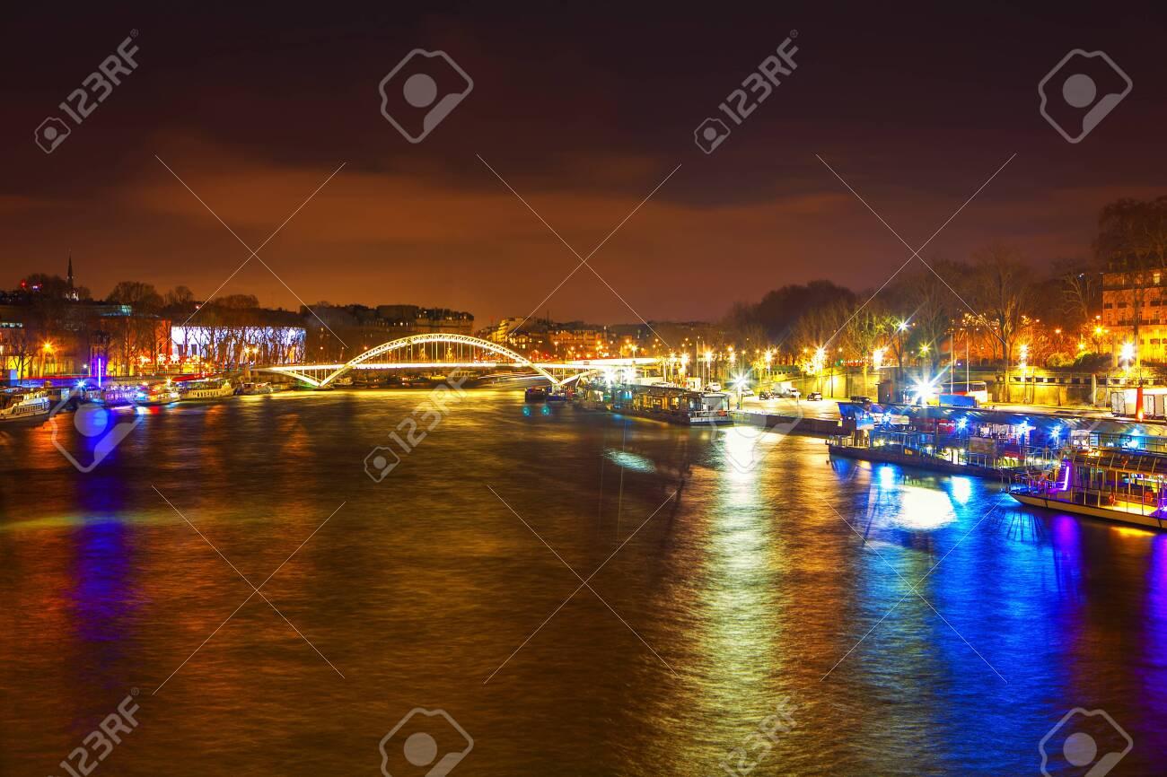 Seine River and bridge at night in Paris - 120196678