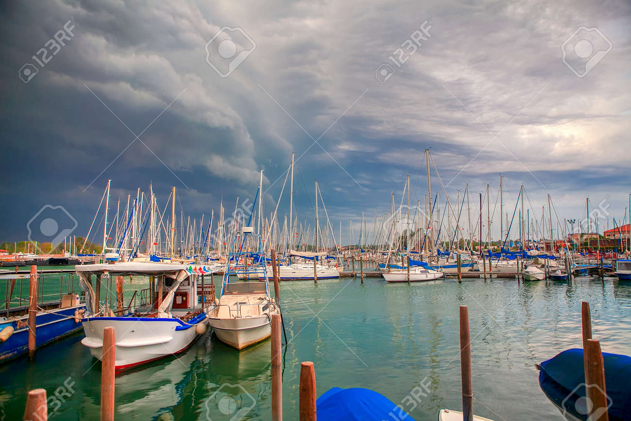 yachts in Venice , clouds over harbor - 120196318