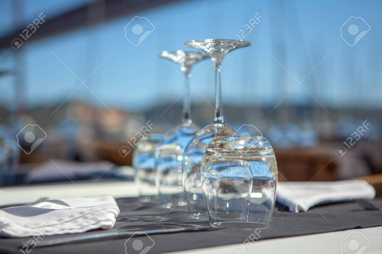 empty glasses on the table in restaurant - 127515472