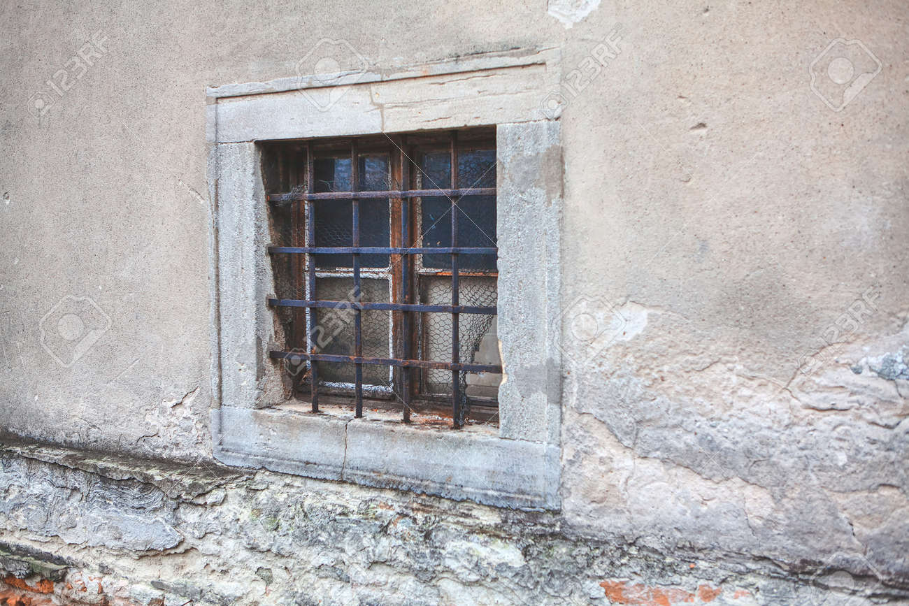 old window with grates of ancient building - 138979722