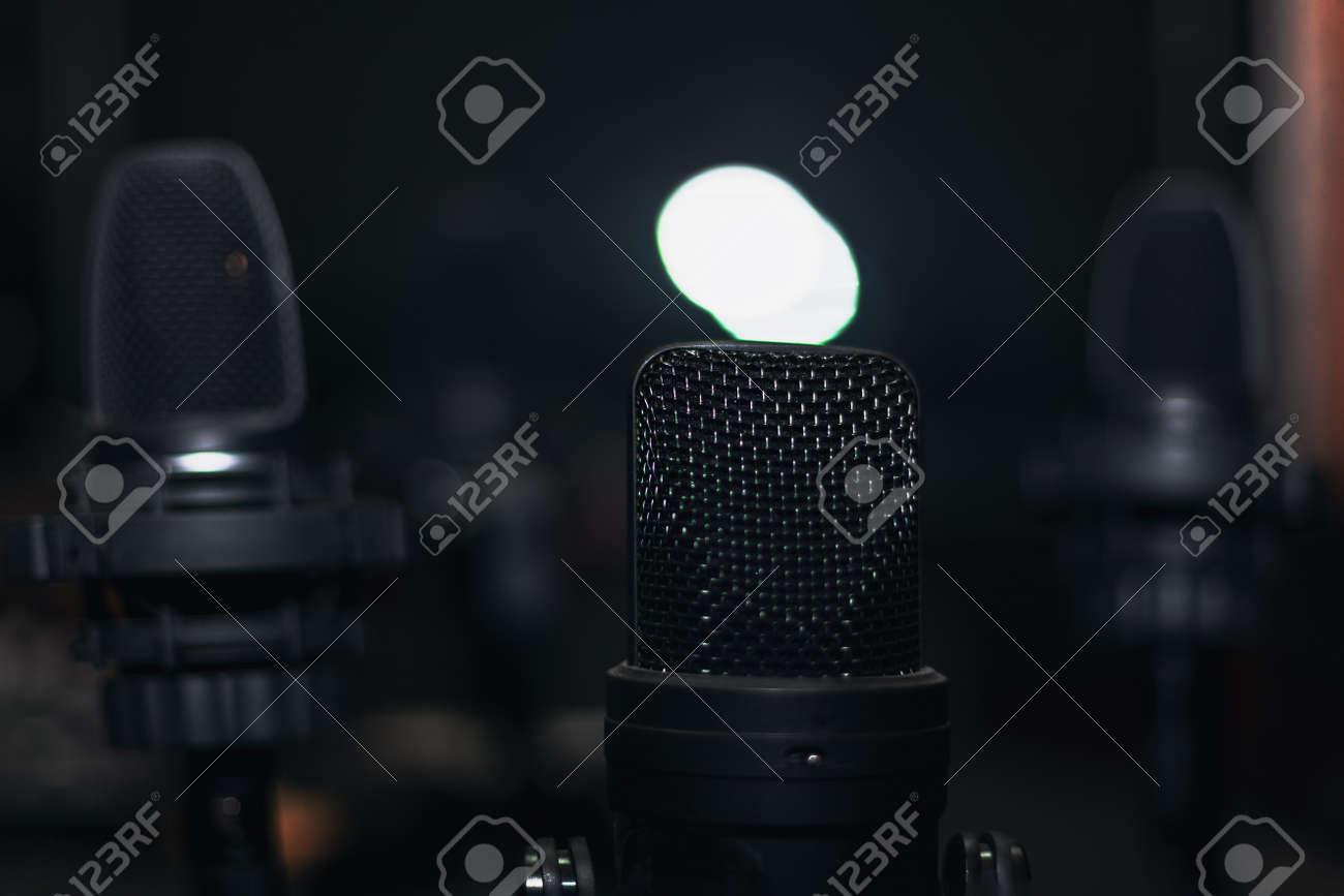 Black microphones in the dark studio - 167986648