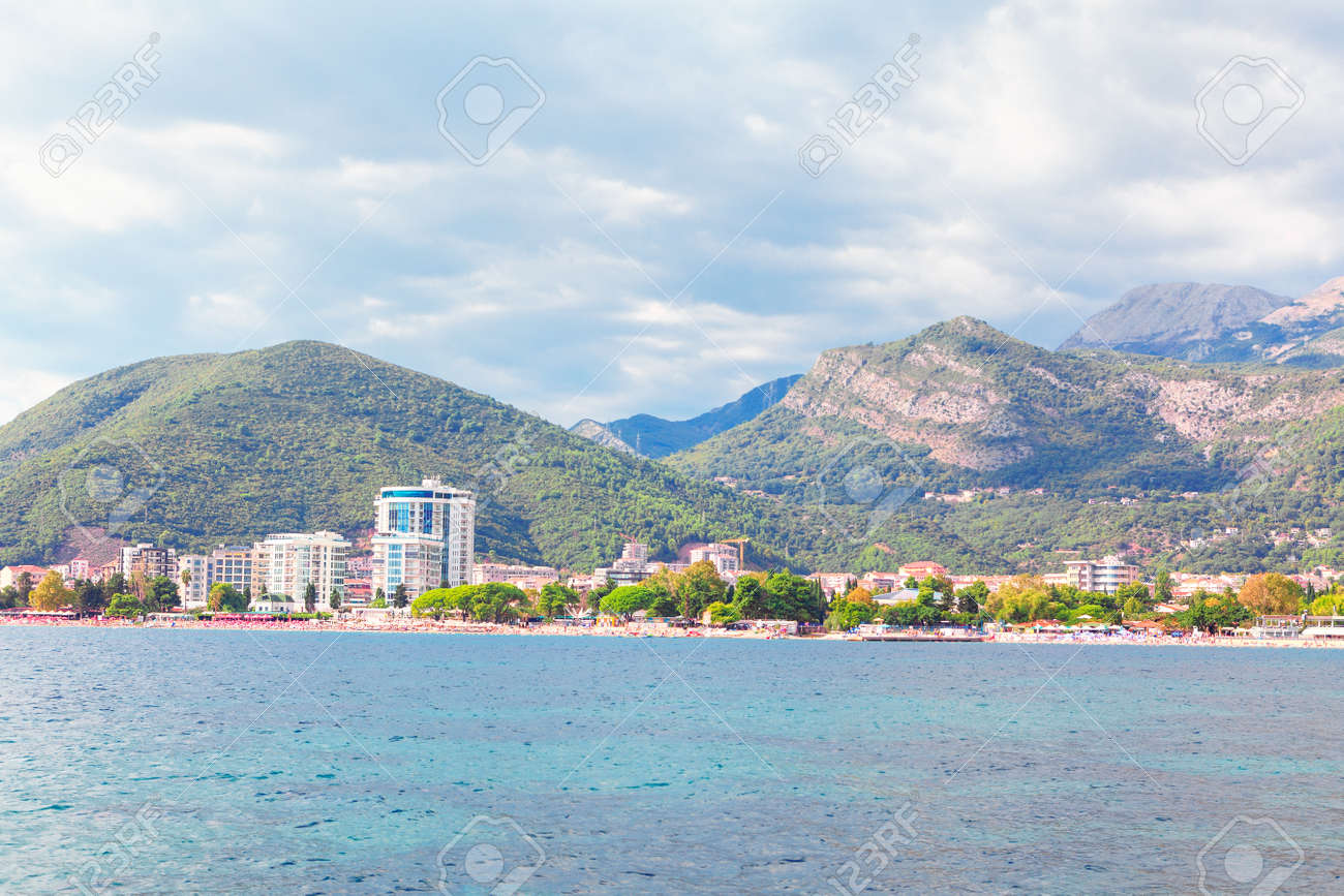 View from the sea to the Budva City in Montenegro . Adiatic Sea and Balkans scenery . Coastal city in Montenegro with resorts and hotels - 167986654