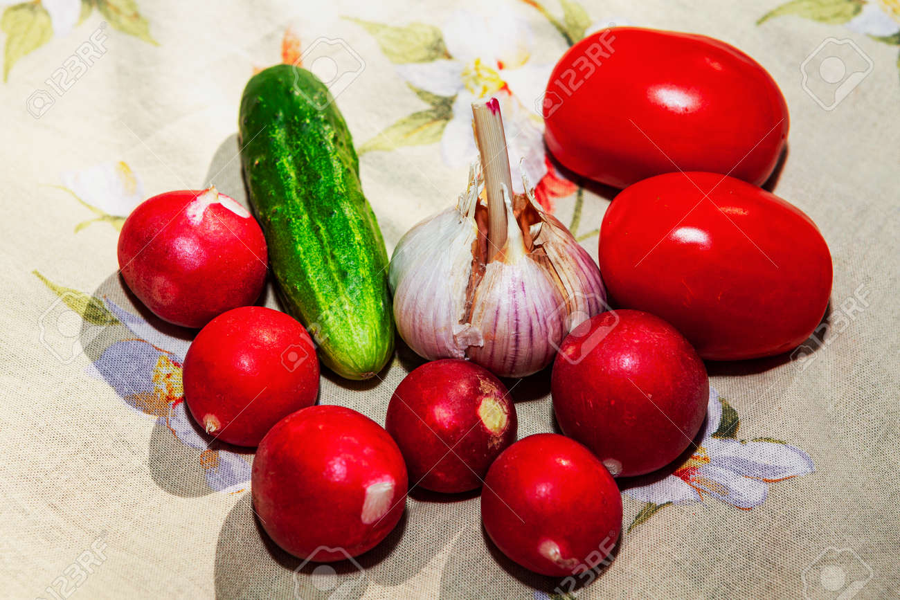 Fresh summer vegetables for salad preparation . Tomatoes , garlic, reddish, cucumbers - 167986829