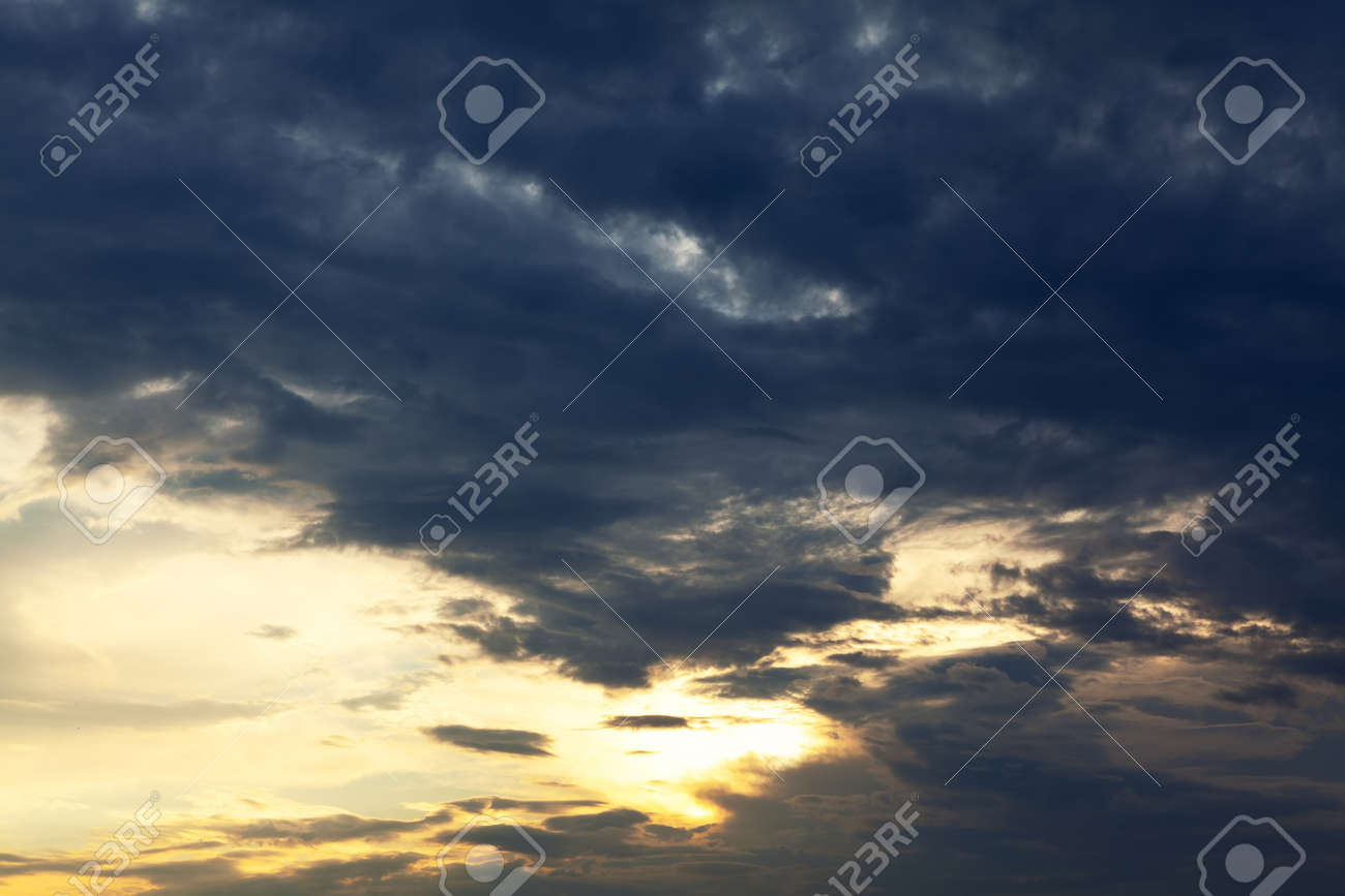 Clouds in contrast . Darkness and brightness on the sky - 167986828