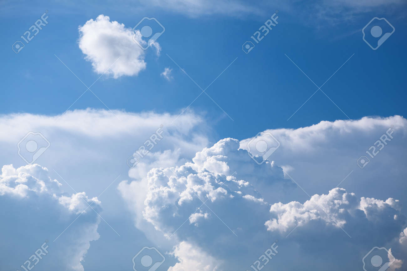 Blue atmosphere with clouds . Summer sky with sunlight - 167986831