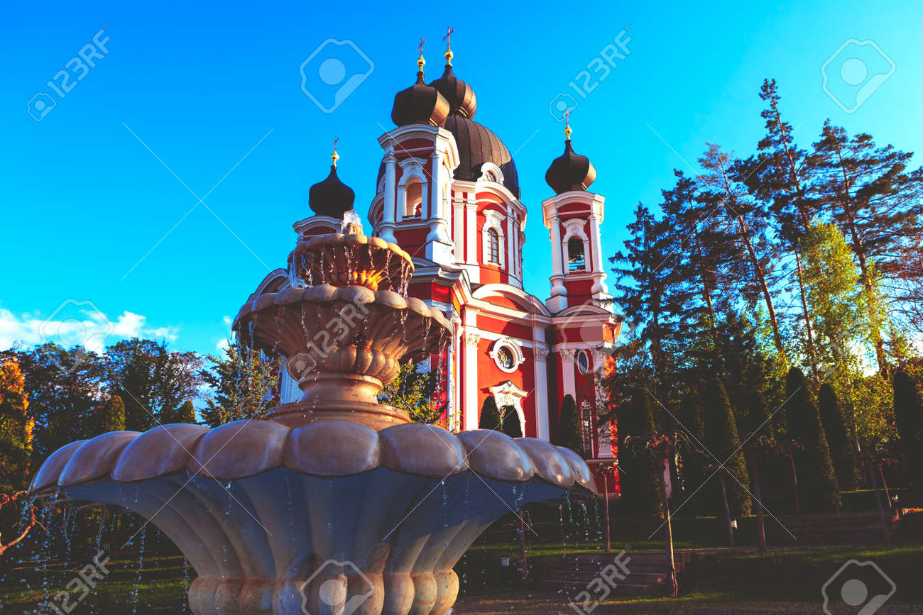 Fountain in the churchyard . Famous monastery and marble fountain in village Curchi from Moldova - 167986836