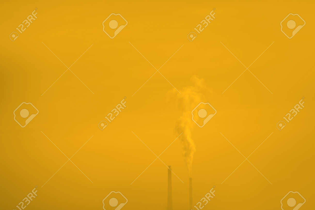 Industrial chimney in yellow fog . Smoke Coming Out from an Industrial Chemical Plant . Global warming concept - 167986839