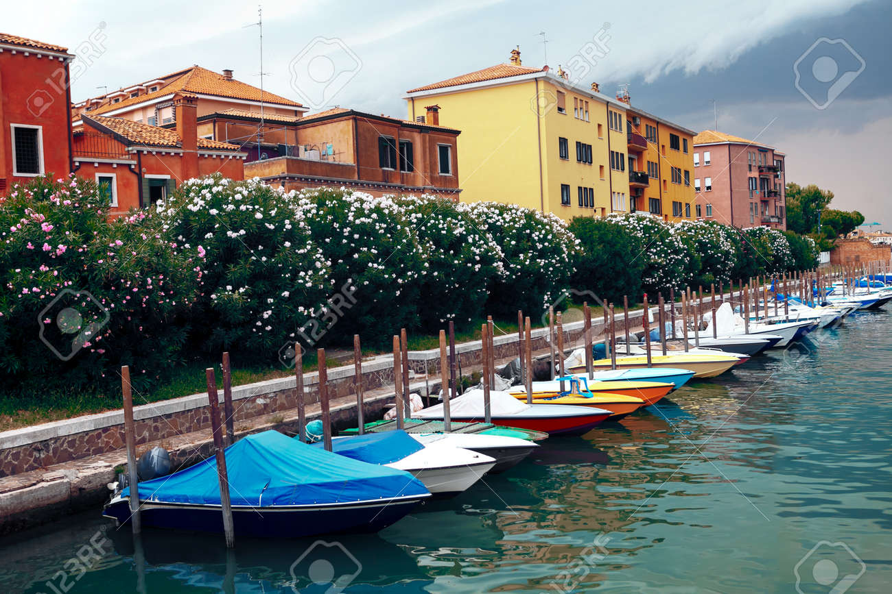 Row of moored boats . Coastal residential district in Venice - 167986898