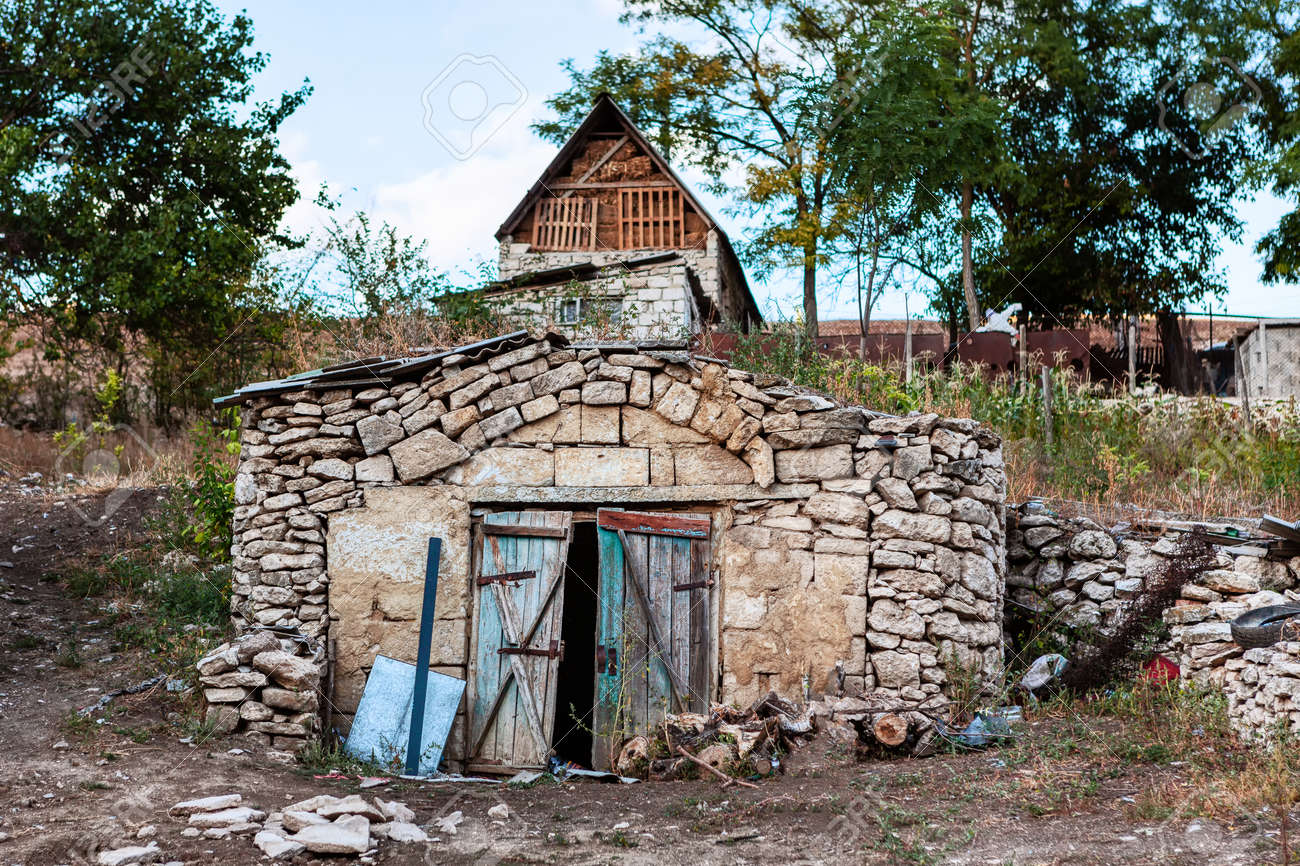 Archaic cellar in the country . Old building for keeping products underground - 169399009