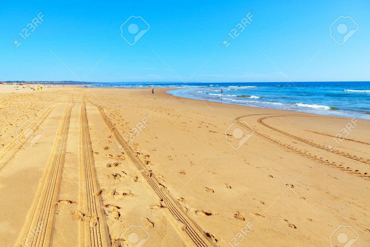 Atlantic Ocean Coastline in the Summer Day . Tractor prints on the sandy beach - 170092644