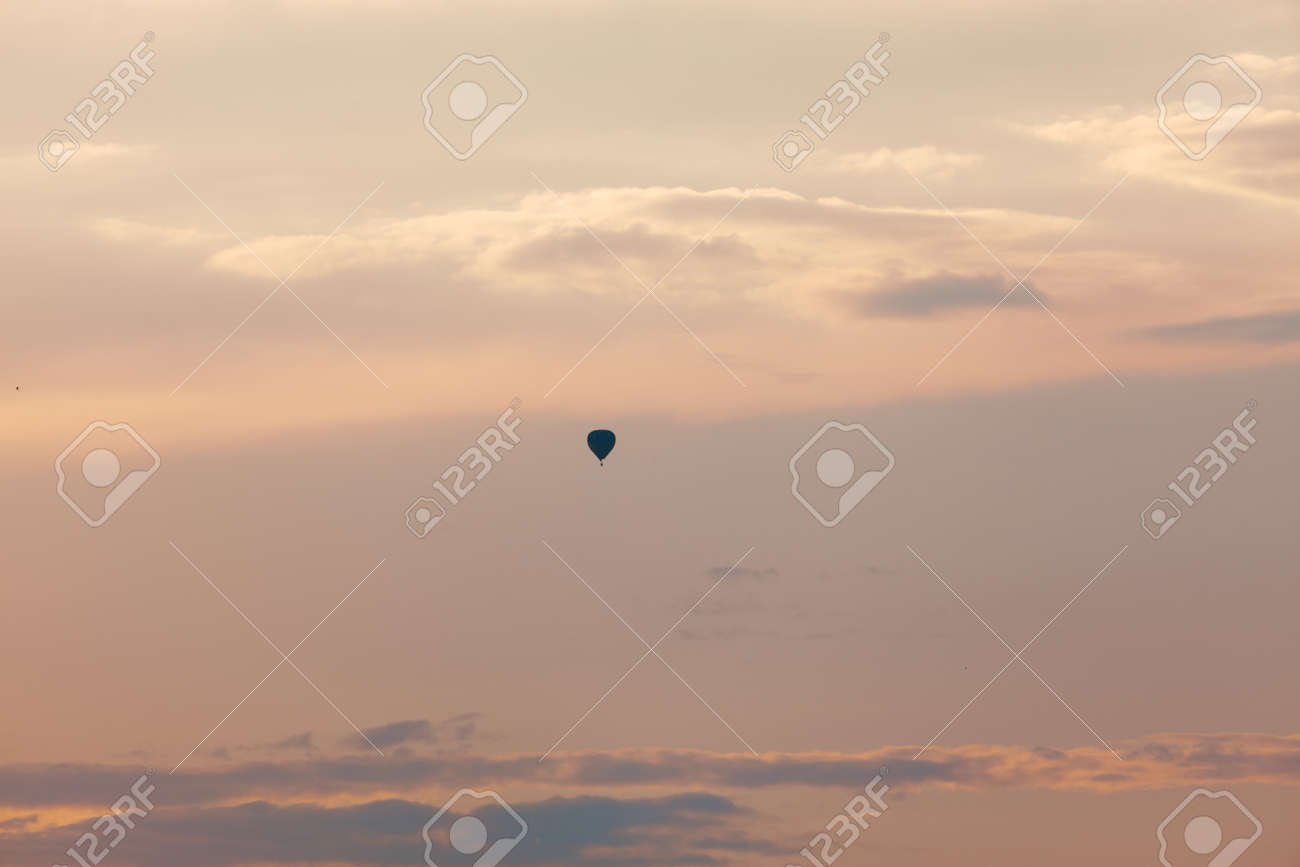 Evening sky with air balloon . Silhouette of hot air balloon flying during sunset, - 170080930