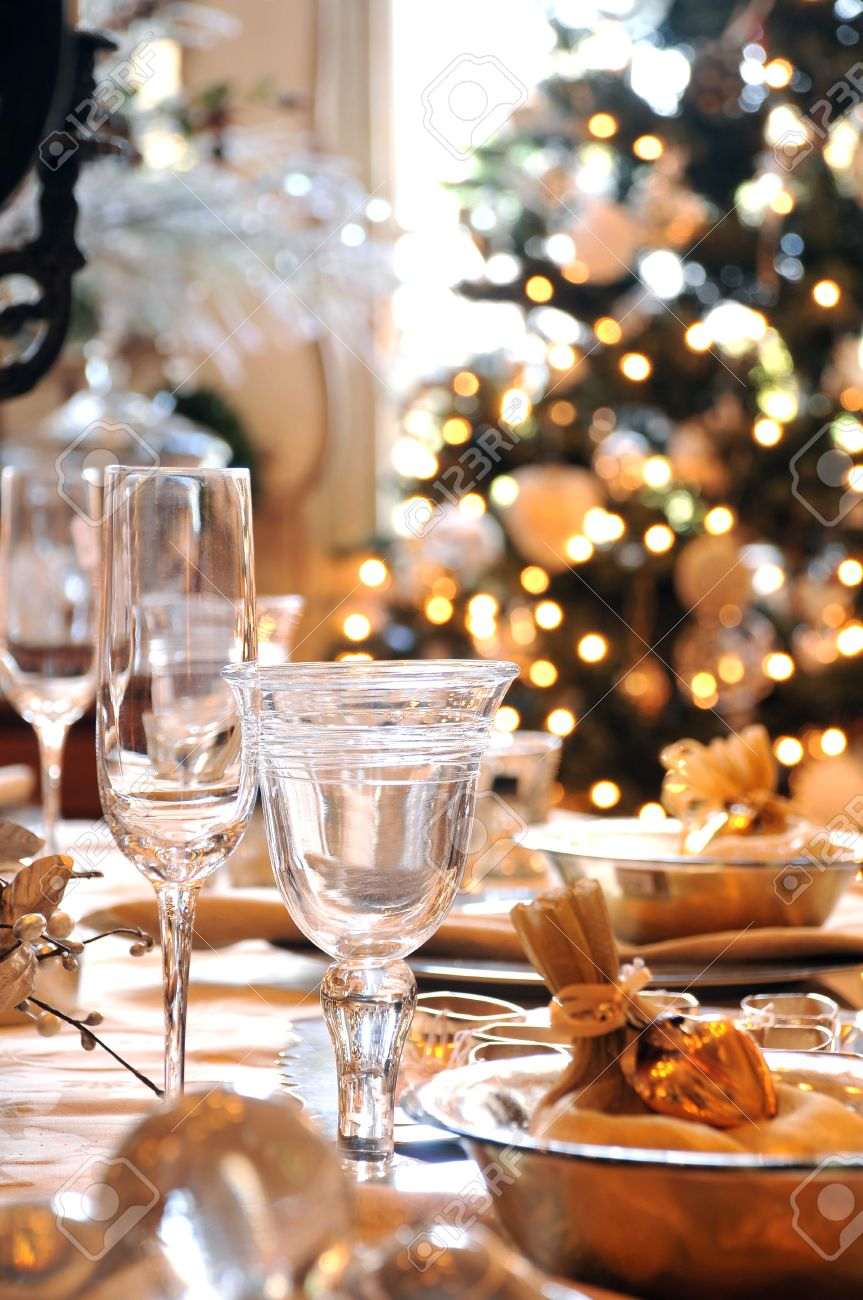 Dinner Table Background a decorated christmas dining table with wine glasses and christmas