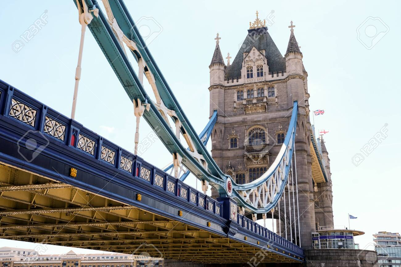 Tower Bridge in London with bridge lowered and blue sky - 132057027