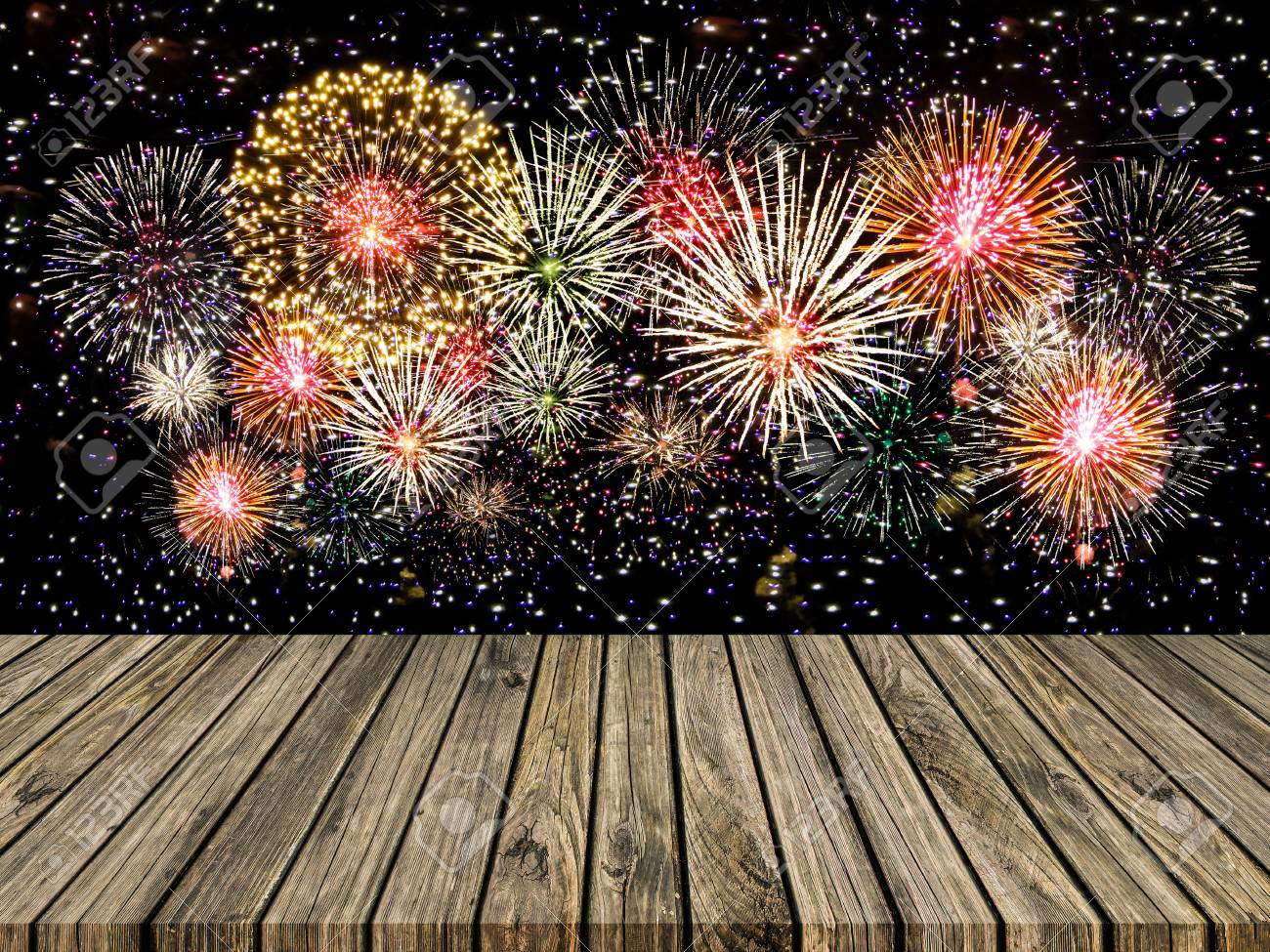 abstract empty wooden floor with fireworks background colorful
