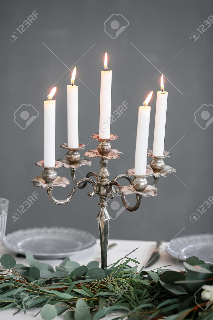 Silver Candlestick And Flowers On A Dinner Table Stock Photo Picture And Royalty Free Image Image 97291699