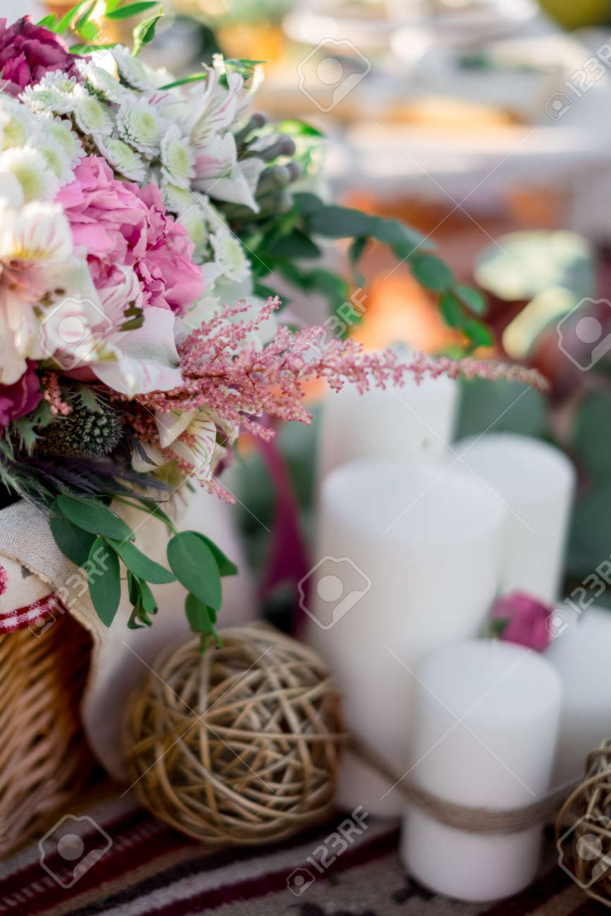 A delicate bouquet of flowers in a basket wedding decoration a delicate bouquet of flowers in a basket wedding decoration in nature stock photo junglespirit Gallery