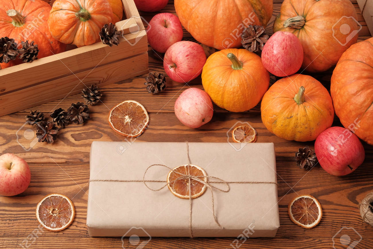 Gift Boxes With Pumpkins Garlands Apples And Cones On A Wooden Stock Photo Picture And Royalty Free Image Image 132059151