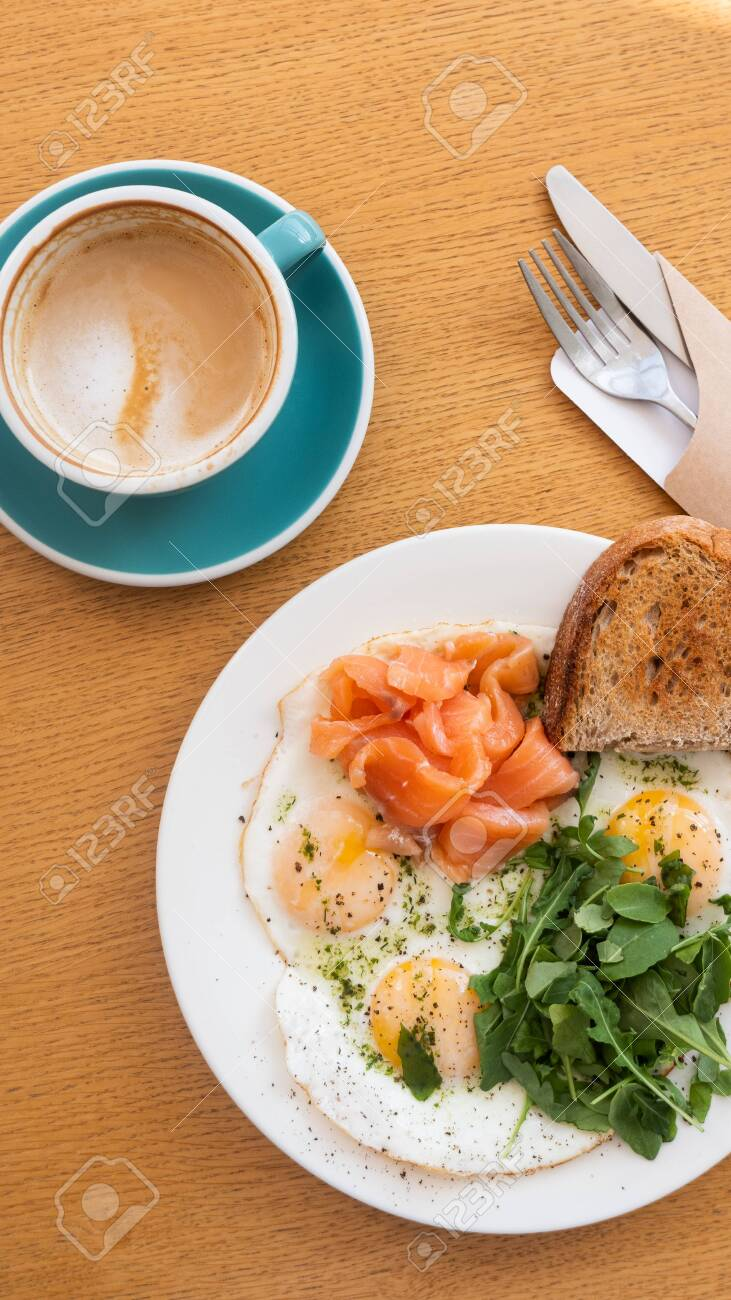 Tasty Healthy Breakfast Fried Eggs Salmon Arugula And Croutons Stock Photo Picture And Royalty Free Image Image 141688570