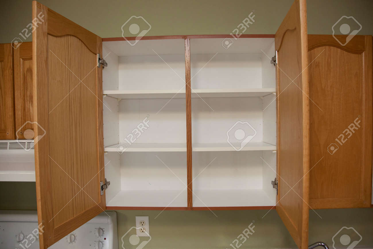 Image of: Kitchen Cabinets With Two Wooden Doors That Are Open Showing Stock Photo Picture And Royalty Free Image Image 122572575