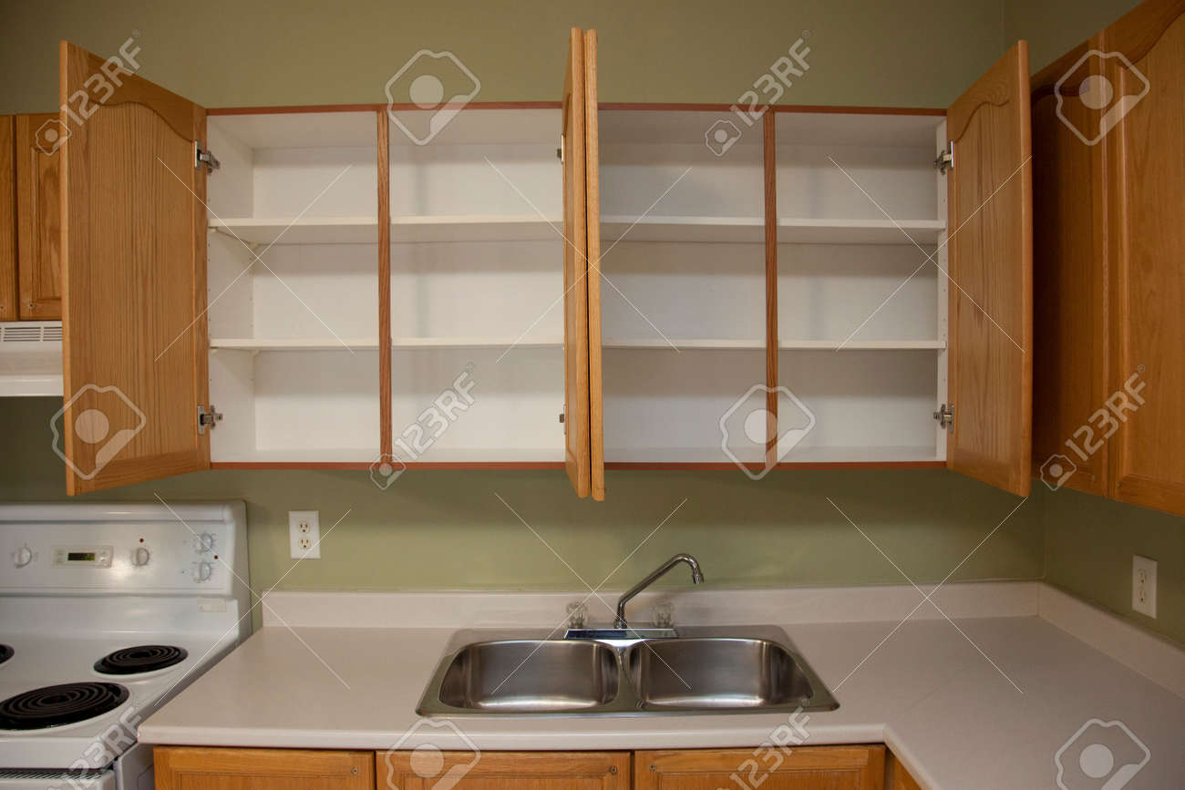 Kitchen Counter Beside A Kitchen Sink With Two Empty Cabinets Stock Photo Picture And Royalty Free Image Image 122572644