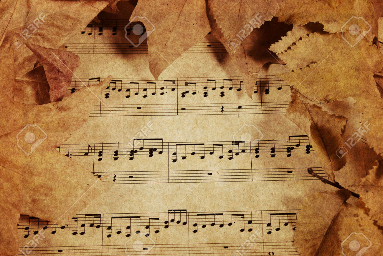 old parchment paper with music and fall or autumn leaves stock photo