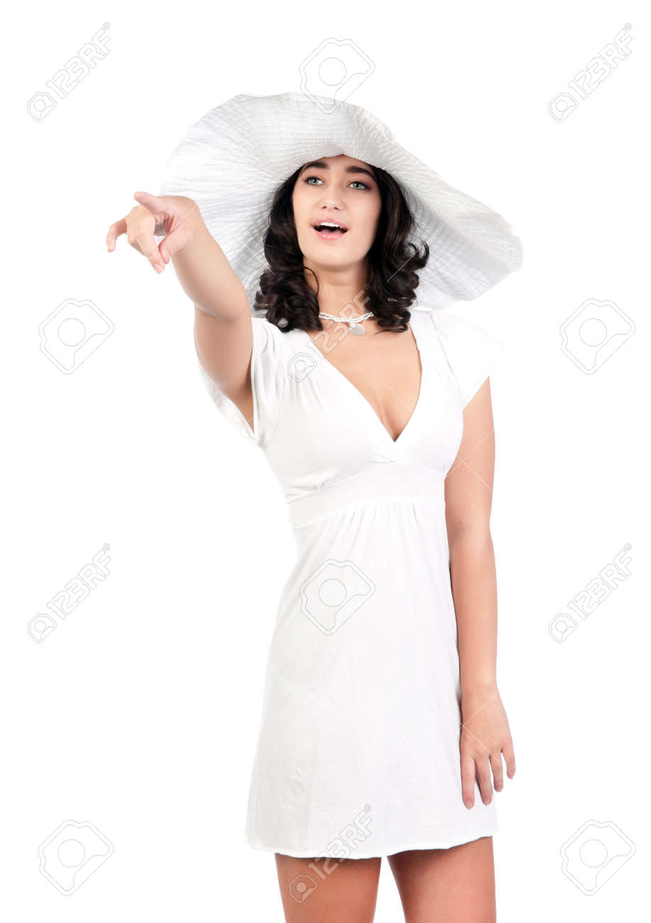 beautiful young fashion woman in white dress and hat pointing Stock Photo - 9420652