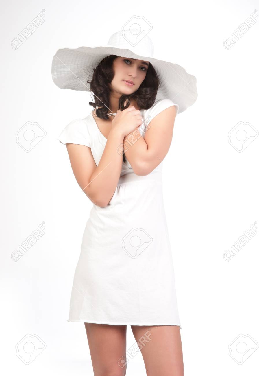 beautiful young fashion woman in white dress and hat Stock Photo - 9420651