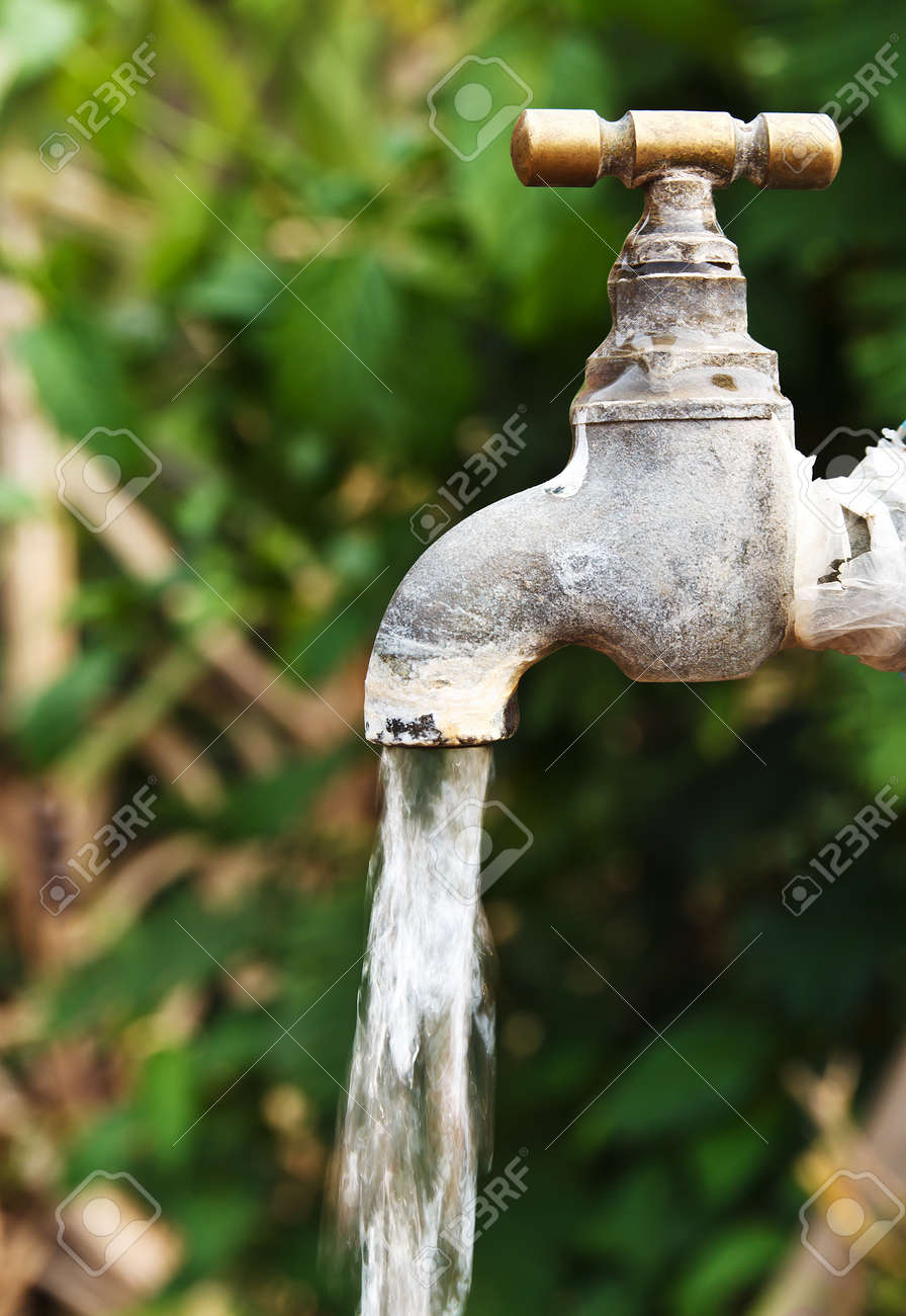 Old Rusty Tap Leaking Water In The Garden Stock Photo, Picture And ...