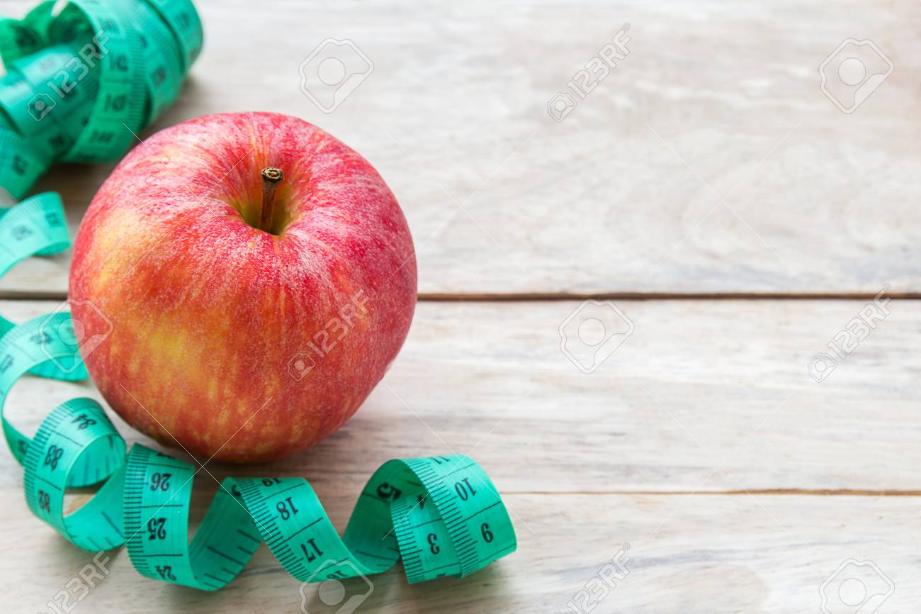 Healthy Lifestyle Concept With Red Apple Weight Loss Or Diet Stock Photo Picture And Royalty Free Image Image 115415925