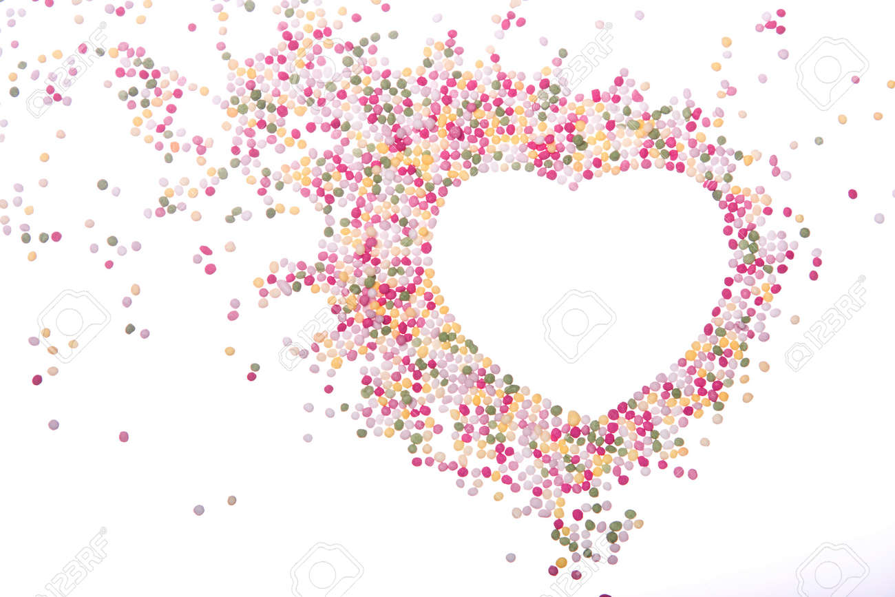 heart shaped frame made from colored sprinkles stock photo 4220618