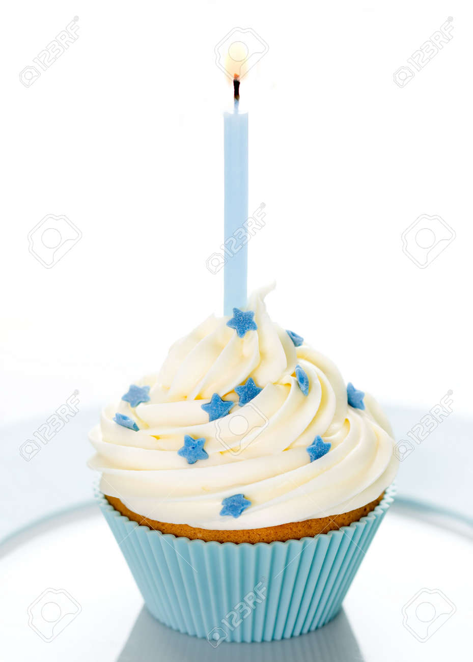 Blue Birthday Cupcake On A White Plate Stock Photo Picture And