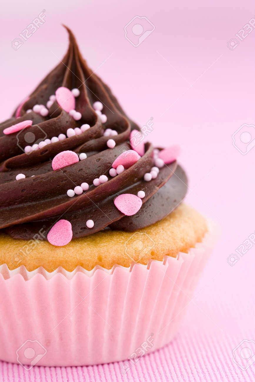 Pink Chocolate Cupcake Against A Pink Background Stock Photo ...