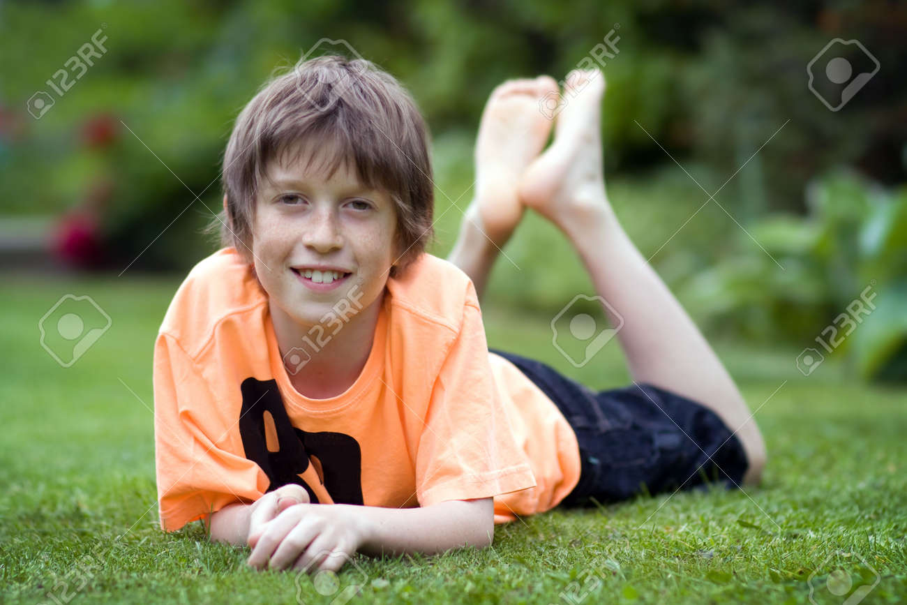 Boy Relaxing On The Lawn Stock Photo 7181683