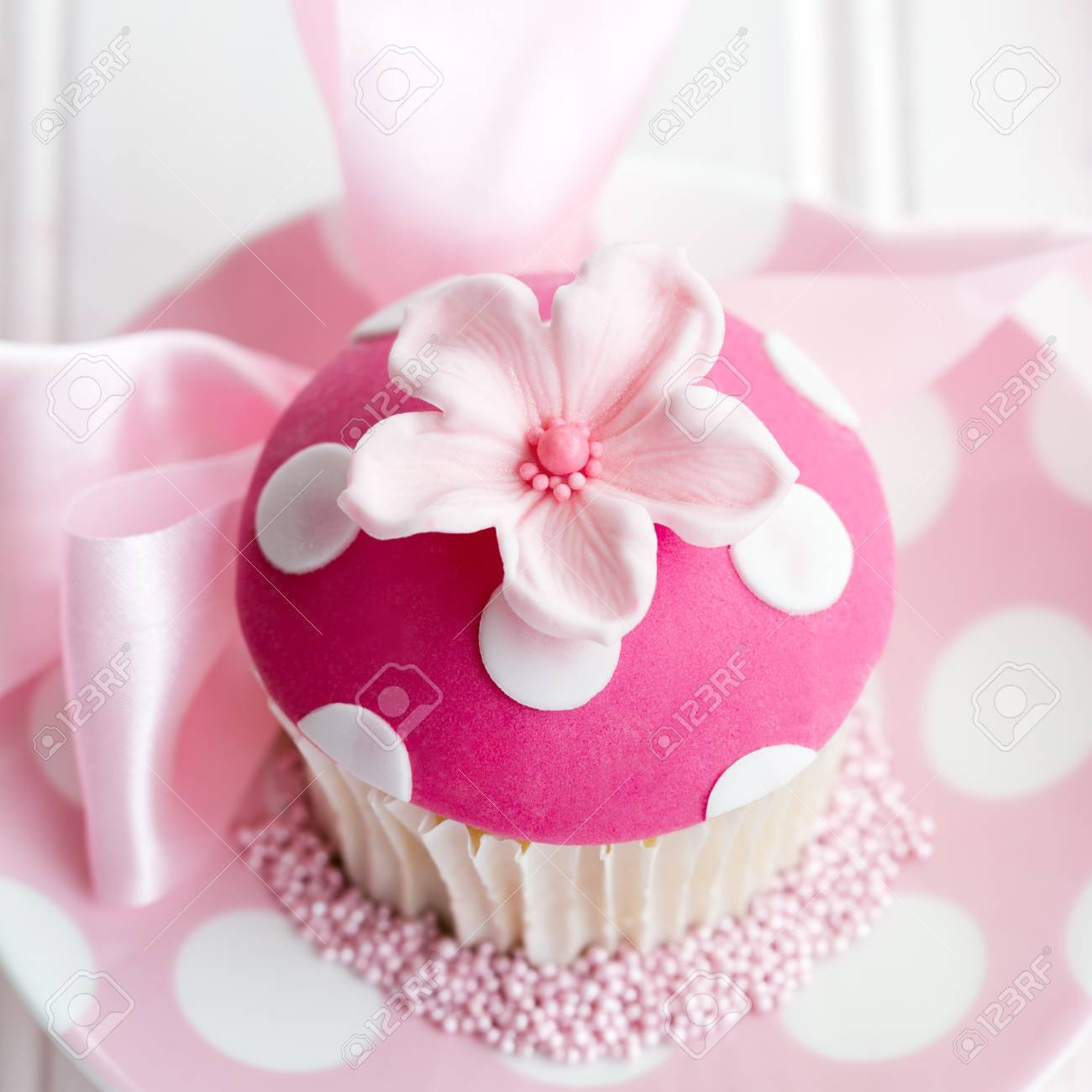 Cupcake Decorated With A Pink Fondant Flower Stock Photo Picture