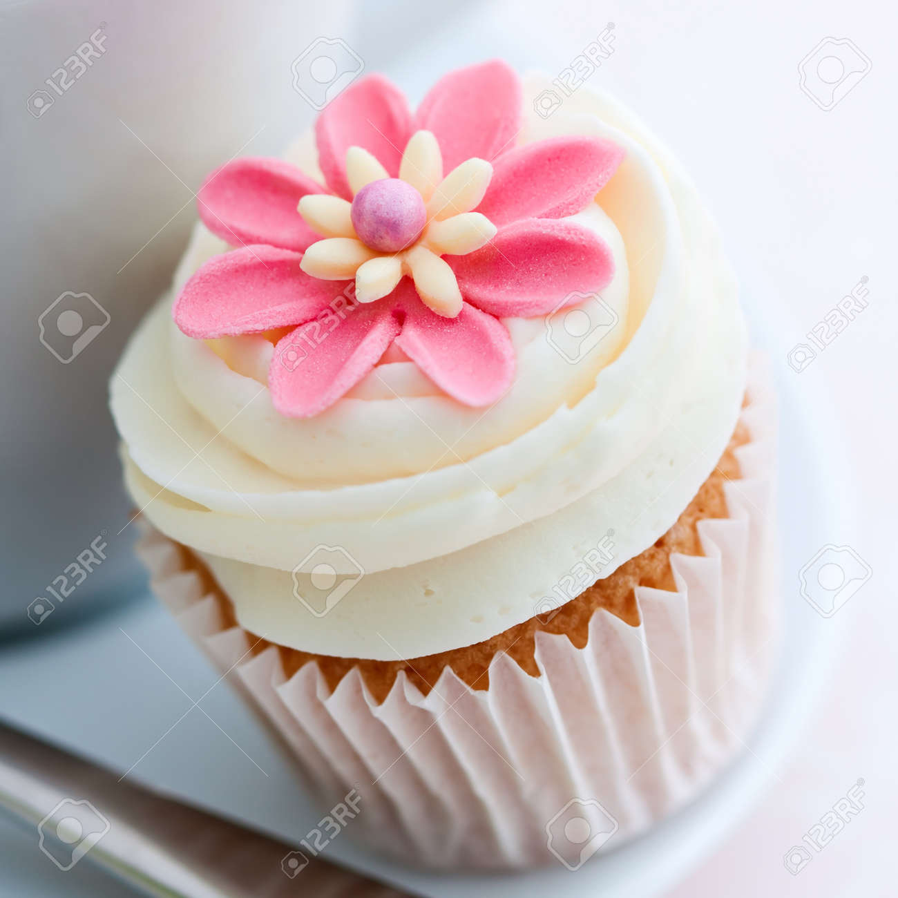 Pink Flower Cupcake Stock Photo Picture And Royalty Free Image