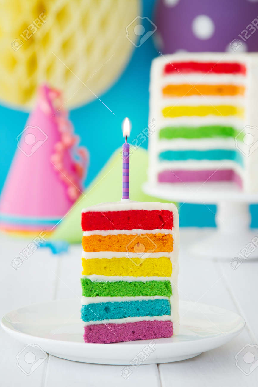Rainbow Cake Decorated With A Single Candle Stock Photo Picture And