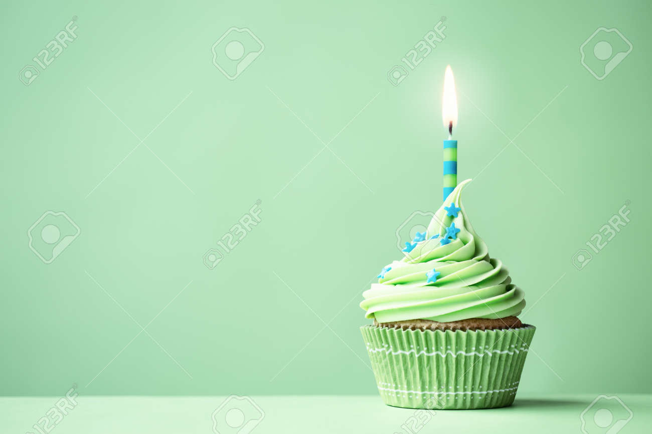 Remarkable Green Birthday Cupcake With Copy Space To Side Stock Photo Birthday Cards Printable Benkemecafe Filternl