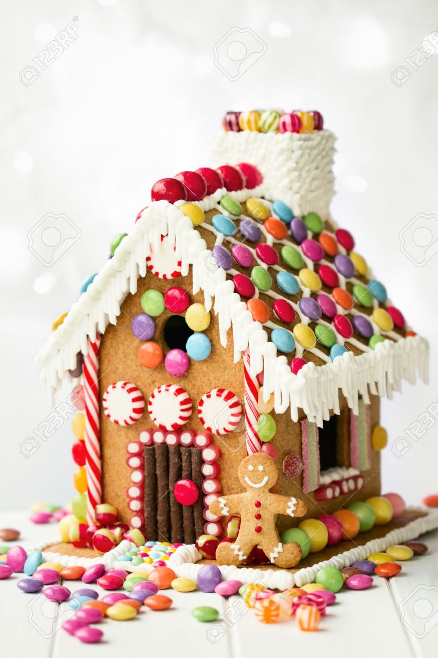 Gingerbread house decorated with colorful candies - 47120345