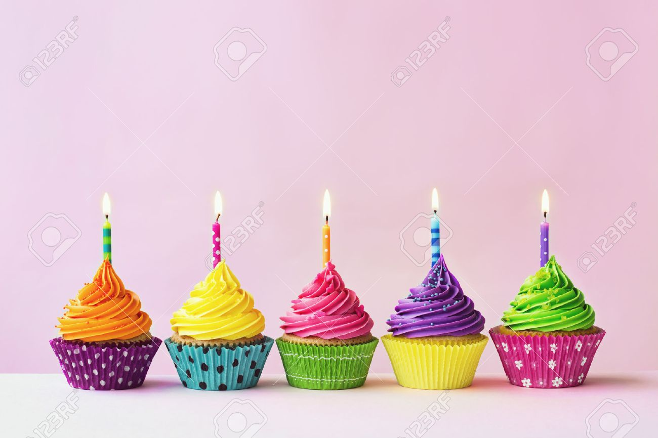 Row of colorful birthday cupcakes - 51187417