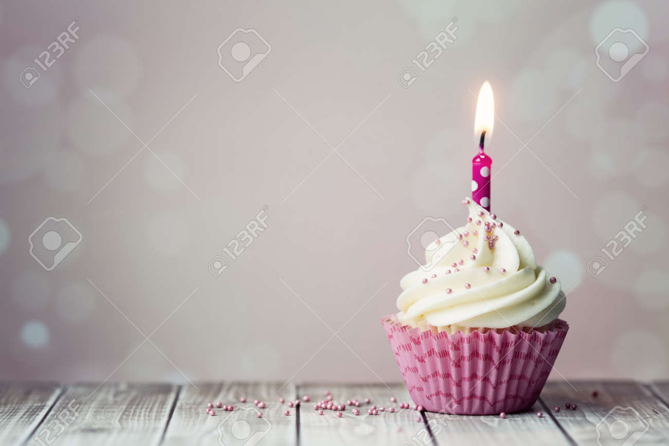 pink birthday cupcake with candle stock photo picture and royalty