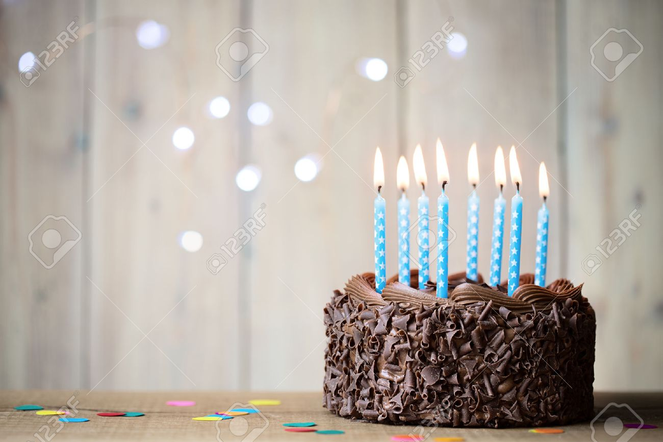 Birthday Cake With Blue Candles Stock Photo