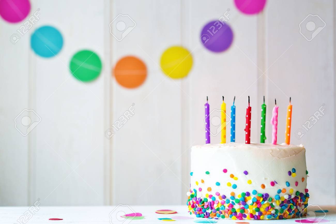 Birthday cake with blown out candles - 52996892
