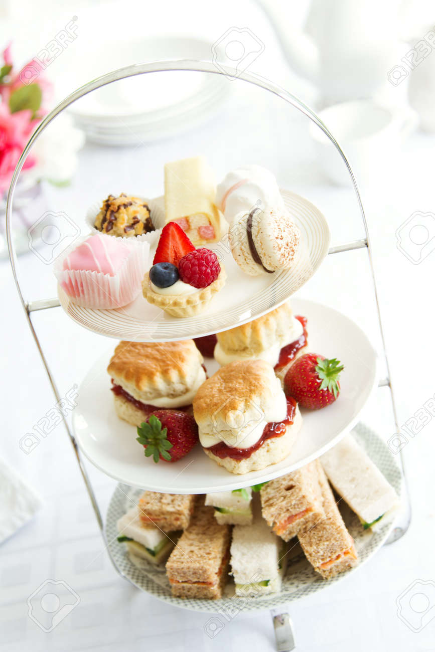 Afternoon tea served on a tiered cake stand - 55852776