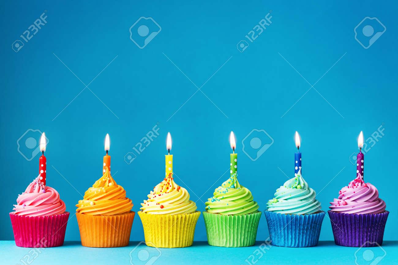 Birthday cupcakes in rainbow colors - 56057335