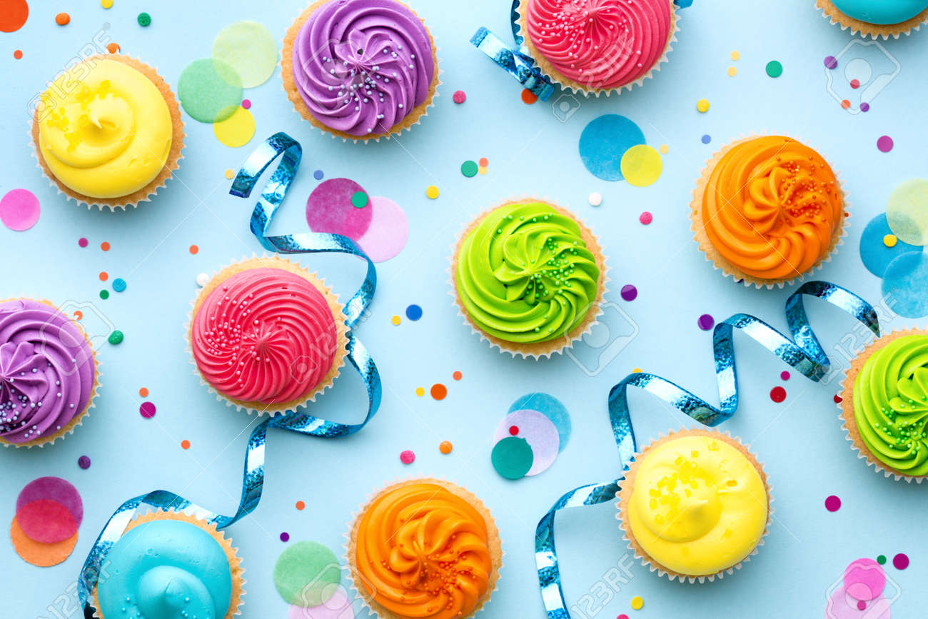 Colorful cupcake party background on blue - 57319396