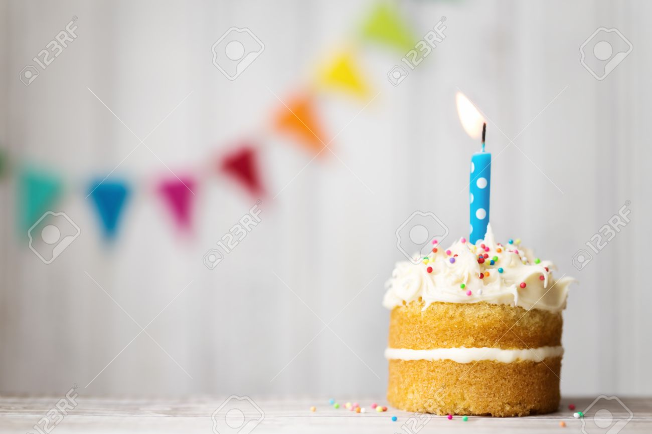 Mini Birthday Cake With A Single Candle Stock Photo Picture And