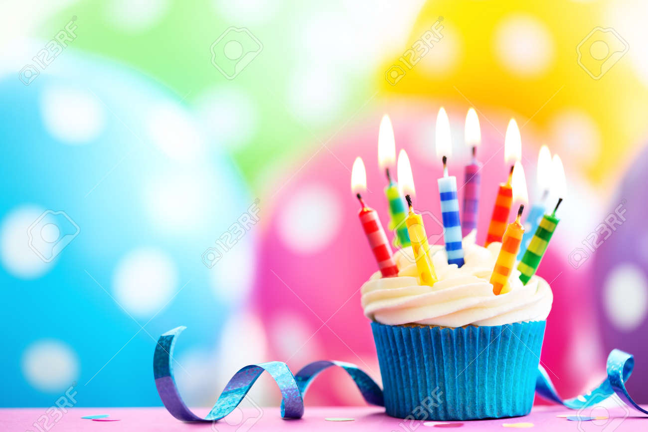 Groovy Cupcake Decorated With Colorful Birthday Candles Stock Photo Birthday Cards Printable Opercafe Filternl